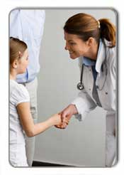 Doctor shaking hands with young girl